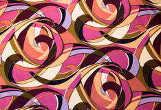 Curved Pattern on Cloth. An abstract pattern of comma shaped colors on cloth Royalty Free Stock Images