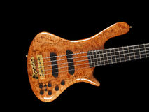 Curved patterned wood bass guitar body on black Royalty Free Stock Images
