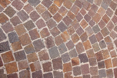 Curved pavement of colorful red granite blocks Stock Image