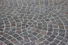 Curved pavement. Fancy curved outdoor paving in the sity. Abstract background texture Stock Image