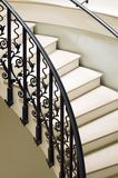 Curved rail. Metal railing of curved staircase inside of large mansion Stock Images