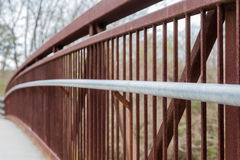 Curved Rail on Rusty Bridge royalty free stock images