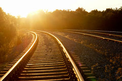 Curved railroad in sunset royalty free stock photography