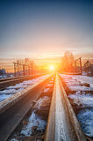 Curved railroad in sunset Royalty Free Stock Photos