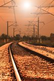 Curved railroad in sunset Stock Photography
