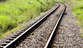 Curved Railway Track Running Through Countryside Stock Photo