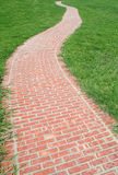 Curved red brick walkway Stock Photo