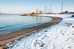 Curved river bank in winter Royalty Free Stock Photography