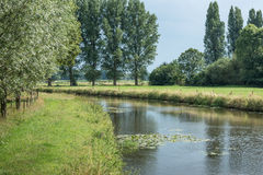 Curved river in a rural landscape in summertime Stock Image