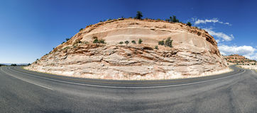 Curved road. Around a rock Royalty Free Stock Photography