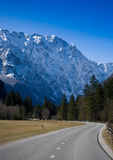 Curved road in alps Stock Photography