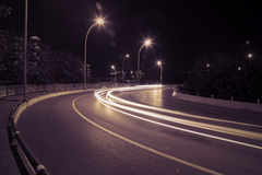 Curved road car light trails Stock Photography
