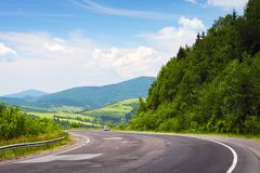 Curved road and car in mountains stock photo