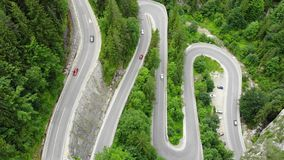 Curved road with cars and beautiful forest landscape. Bicaz gorges, Romania. Aerial view from drone stock footage