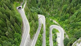 Curved road with cars and beautiful forest landscape. Bicaz gorges, Romania. Aerial view from drone stock video