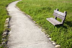 Curved road and chair Royalty Free Stock Photo