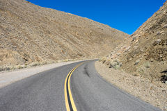 Curved road in death valley. Road through death valley desert california Royalty Free Stock Photography