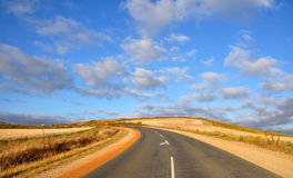 Curved road in fields Royalty Free Stock Photo