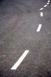 Curved road line markings Stock Image