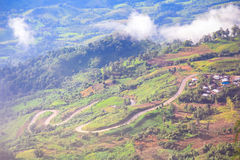 Curved road on mountains Royalty Free Stock Image