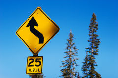 Curved road sign Stock Photography