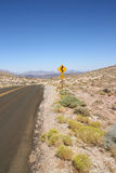 Curved road sign in Death Valley National Park Stock Photo
