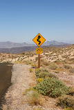 Curved road sign in Death Valley National Park Royalty Free Stock Photo