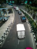 Curved road - Street view of Bangkok Metropolis, shooting from the top of an overpass. Bangkok / Thailand - March 20 2019: Curved road - Street view of Bangkok stock photography
