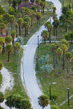 Curved Road To Beach. Curving roadway leading to the beach in Miami Beach, Florida (USA). Aerial view stock photos