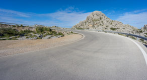 Curved road to heaven. Mountain s-shape curved road to heaven, blue sky Royalty Free Stock Image