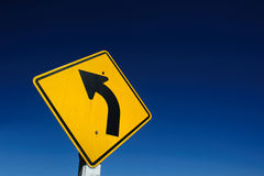 Curved Road Traffic Sign over Stock Photos