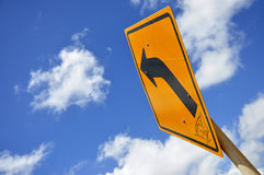 Curved Road Traffic Sign under the blue sky Royalty Free Stock Photo