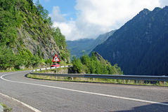 Curved roads in high mountains royalty free stock photography