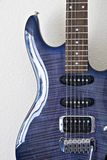 Curved section of blue guitar. Curved section with highlights of blue electric guitar with strings and neck Royalty Free Stock Image