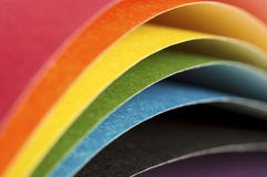 Curved sheets of colored paper Stock Image