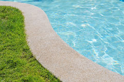 Curved side of swimming pool Stock Image
