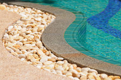 Curved side of a swimming pool Stock Images