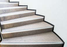 Curved staircase. Classic curved staircase with wooden handrial Stock Photo