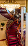 Curved Staircase Under Chandelier Royalty Free Stock Photos