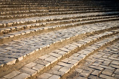 Curved stairs. Full-frame detail of some curved steps, a restored old Roman architectural detail which originally formed seating in ancient open air theatre stock photography