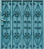Curved steel pattern on door with handle Stock Images