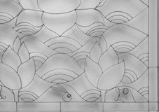 Curved steel. Shape of lotus and wave curved steel which has sunlight shadow on the wall background, black and white tone Stock Photo