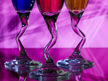 Curved stems of wine glasses Royalty Free Stock Image