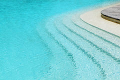 Curved steps in swimming pool Stock Photo
