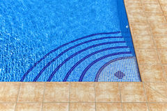 Curved steps into swimming pool Royalty Free Stock Photo