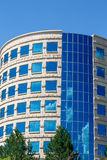 Curved Stone and Blue Glass Office Tower Stock Photos