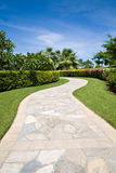 Curved stone footpath in a garden Royalty Free Stock Image
