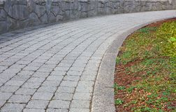 Curved stone path Royalty Free Stock Photo