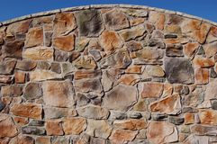 Curved Stone Wall royalty free stock photography