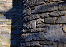 Curved stone wall Stock Photography